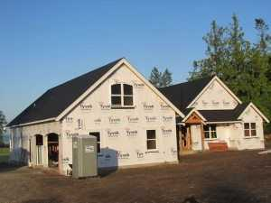 Another view of a Spane Buildings post frame home being built in Puyallup WA