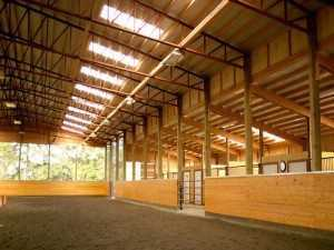 The ceiling of an arena built by Spane Building in Redmond Washington complete with horse barn